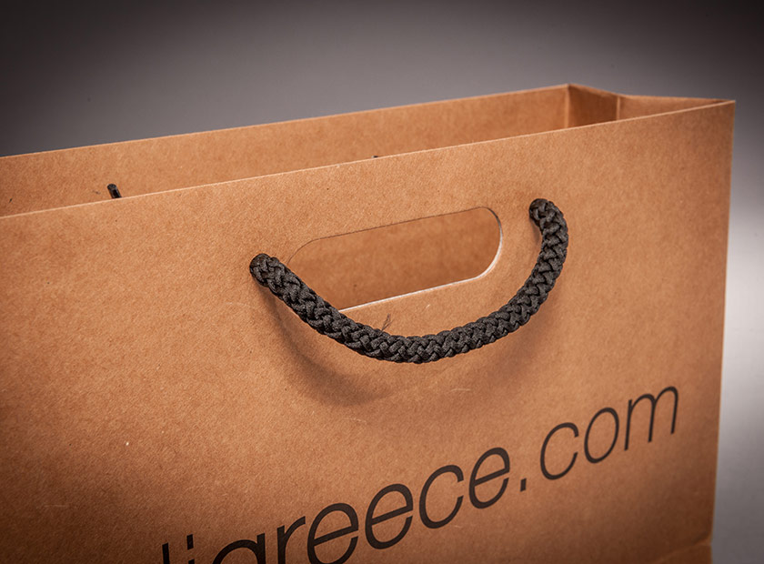 Individually printed paper bag with combined handle/cord
