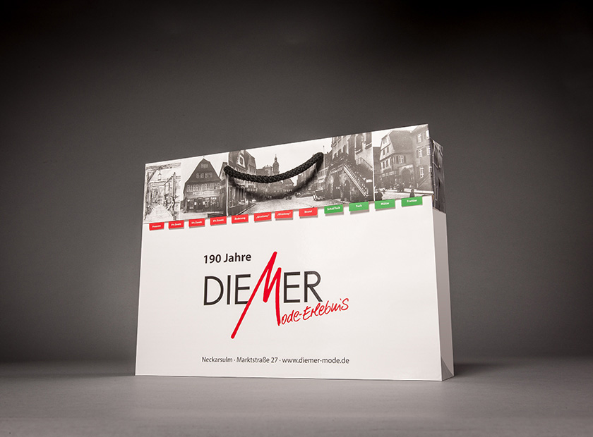 Printed paper carrier bag with detachable coupon, DIEMER logo