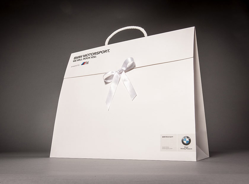 Paper gift bag with cover flap and bow, BMW logo