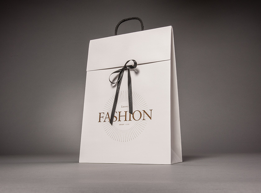 Paper gift bag with cover flap and bow, fashion motif