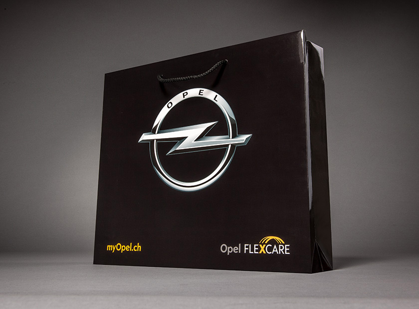 Printed paper bag with cord, VW Opel logo